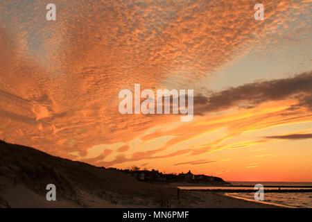 A beautiful orange glow sunset on Cape Cod Bay at Cold Storage Beach, East Dennis, Massachusetts - Stock Photo
