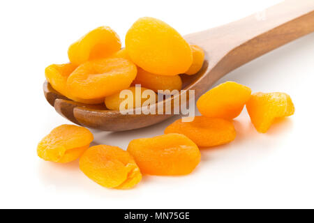 Whole dried apricots fruit in wooden spoon over white background - Stock Photo