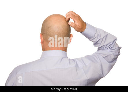 A rear view of a man scratching his head, isolated on white. - Stock Photo