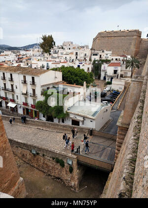 Ibiza Island, Spain - May 5, 2018: Old town of Ibiza. Tourists at the main entrance to the walled enclosure of Ibiza, it was built between 1584 and 15 - Stock Photo