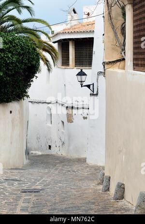 Empty cobblestone white-washed street of old town of Ibiza (Eivissa), Balearic Islands. Spain - Stock Photo