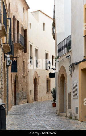 Charming empty cobblestone street of old town of Ibiza (Eivissa), Balearic Islands. Spain - Stock Photo