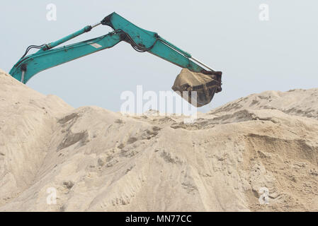 excavator is digging sand - Stock Photo
