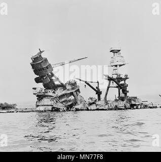Wreckage of USS Arizona after Imperial Japanese Navy Air Service Attack, Pearl Harbor Hawaii, Office of Emergency Management, December 7, 1941 - Stock Photo
