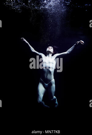 Submerged in an ocean of depression - Stock Photo