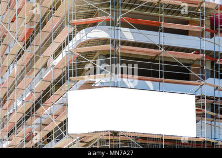 Blank space on a scaffolding building for your advertising. white mockup - Stock Photo