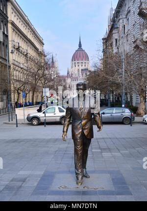 Budapest, Hungary - March 28, 2018: Statue of the former U.S. President Ronald Reagan on the background of Hungarian Parliament Building. Statue by sc
