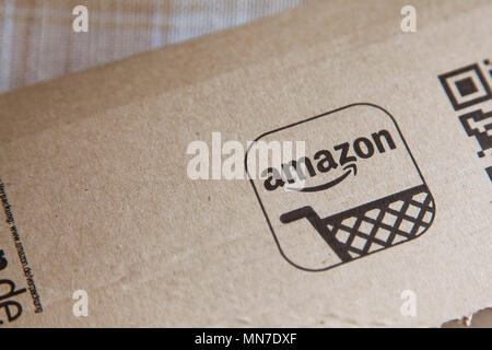 OXFORD, UK - MAY 22nd 2017: Amazon logo on a parcel. Amazon is the largest online retailer in the world and was founded in 1994 - Stock Photo