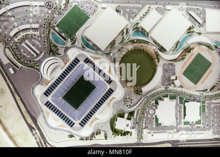 Doha, Qatar. 13th May, 2018. DOHA, QATAR - MAY 13, 2018: A mock-up of Ahmed bin Ali Stadium, a venue for 2022 FIFA World Cup football matches, in the city of Al Rayyan, seen at the Headquarters of the Qatar 2022 Local Organising Committee (LOC). Mikhail Aleksandrov/TASS Credit: ITAR-TASS News Agency/Alamy Live News - Stock Photo