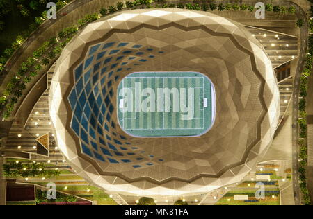 Doha, Qatar. 13th May, 2018. DOHA, QATAR - MAY 13, 2018: A mock-up of Ahmed bin Ali Stadium, a venue for 2022 FIFA World Cup football matches, seen at the Headquarters of the Qatar 2022 Local Organising Committee (LOC). Mikhail Aleksandrov/TASS Credit: ITAR-TASS News Agency/Alamy Live News - Stock Photo