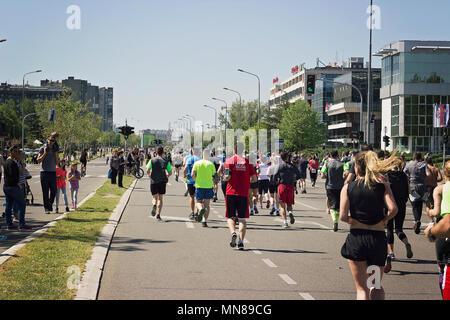 BELGRADE, SERBIA - APRIL 21st, 2018: Marathon runners running on city road - Stock Photo