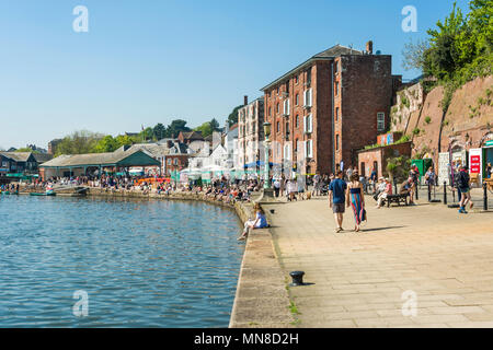 Locals and tourists strolling and shopping at Exeter Quay on a sunny Sunday afternoon, Exeter, UK. - Stock Photo
