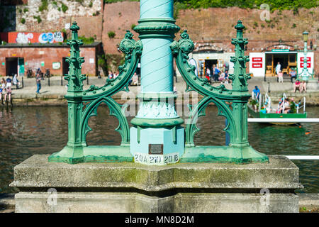 The base of an ornamental lamp standard that was preserved from the 1905 Exe Bridge.  It was cast by Macfarlanes of Glasgow. - Stock Photo