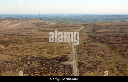 aerial view looking east towards Emley Moor TV mast from a moorland road on the Pennines near Oldham, UK - Stock Photo