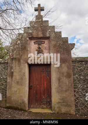 A large wooden studded Door set into a high stone wall, leading into a Walled garden on a property in Blairgowrie, Perthshire, Scotland - Stock Photo