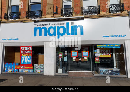 A branch of the former electronic goods chain Maplin in the United Kingdom, pictured in 2018 while advertising a store closing sale. - Stock Photo
