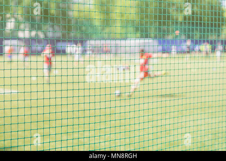 Football training on sports field. Soccer school. Sportsmen, football players on Sports training. Football outdoor stadium. Blurred image for Backgrou - Stock Photo