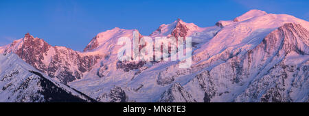 Mont Blanc mountain range at sunset in Upper Savoy. From left to right, Aiguille du Midi needle, Mont Blanc du Tacul, Mont Maudit, Mont Blanc and Dome - Stock Photo
