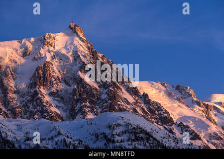 Aiguille du Midi needle at sunset with view on the glaciers of the Mont Blanc mountain range. Chamonix, Haute-Savoie (Upper Savoy), Alps, France - Stock Photo