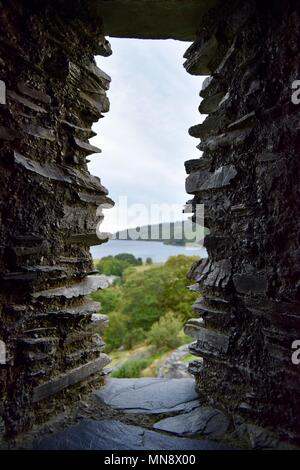 looking out of ruins window. Dolbadarn Castle: Castle Dolbadarn ruins, Llanberris, Snowdonia, Wales, Great Britain. - Stock Photo