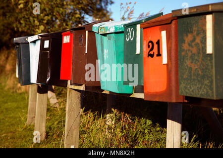 Mailboxes on line in varying condition. - Stock Photo