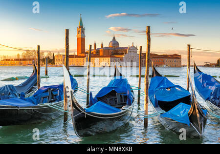 Venice gondolas near San Marco square at sunrise, Grand Canal, Venice, Italy. - Stock Photo