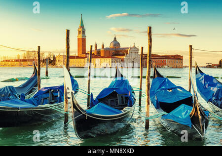 Venice gondolas near San Marco square at sunrise, Grand Canal, Venice, Italy. Vintage post processed. - Stock Photo