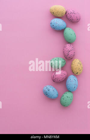 Mini speckled easter eggs from above on colourful backgrounds, with copyspace. - Stock Photo