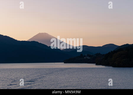 Mt. Fuji in the sunset from a boat on Lake Ashi in Hakone - Stock Photo