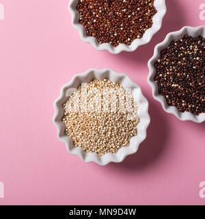 Quinoa in white bowls - Stock Photo
