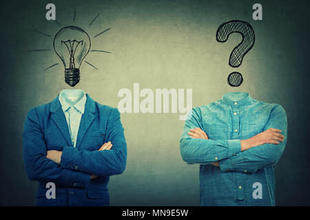 Two crossed hands businessmans with drawn bulb and interrogation mark instead of head. Problem and solution concept. - Stock Photo