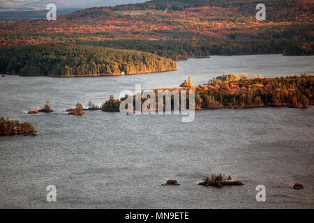 Mountains and Squam Lake in New Hampshire at fall time - Stock Photo