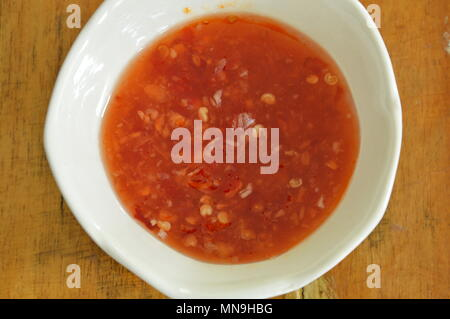 chicken chili sauce in cup on table - Stock Photo
