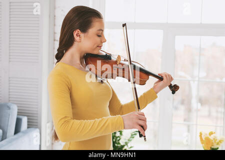Attentive female person practicing new work - Stock Photo