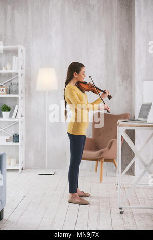 Attentive brunette learning new work - Stock Photo
