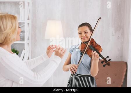 Joyful violinist having useful lesson - Stock Photo