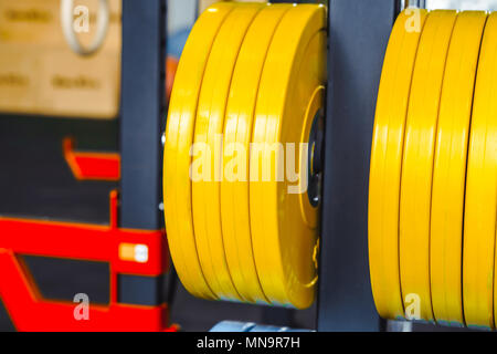 pancakes for rod hanging on bracket in sportshalle - Stock Photo