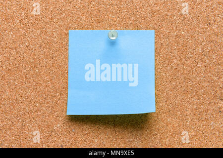 empty square blue pinned sheet on a brown cork reminder - Stock Photo