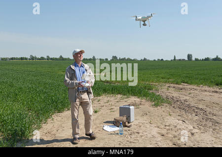man flying drone - Stock Photo
