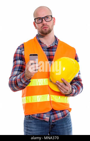 Young bald muscular man construction worker - Stock Photo