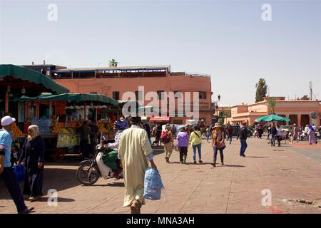 Jemaa el-Fnaa, the main square of Marrakesh and market place in Marrakesh's medina quarter, used by locals and tourists. - Stock Photo