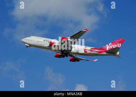 Virgin Atlantic Boeing 747 Jumbo Jet jet plane airliner taking off from London Heathrow Airport, UK. Boeing 747-400 G-VFAB in blue sky. Space for copy - Stock Photo