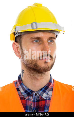 Young handsome bearded man construction worker - Stock Photo