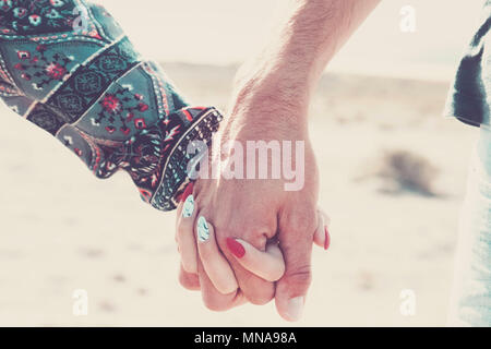 love forever together concept with a pair of caucasian young hands hug and touch under the sunlight. vacation summer time and vintage colors. new mode - Stock Photo