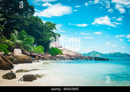 Scenic view of sea against blue sky, Island of La Digue, Seychelles - Stock Photo