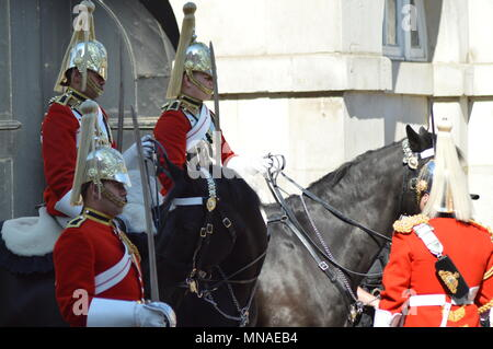 The 4 pm Dismounting Ceremony at Horse Guards Parade is every day 365 days a year. The Queens Life Guards have been at Horse Guards Parade since the Restoration King Charles II in 1660. The Queens Life Guards is one of two Senior Household Cavalry Regiment. When the Queen is in Residence at Buckingham Palace, The Guard consists of one Officer, One Corporal Major, two Non Commissioned Officers, One Trumpeter and Ten troopers. This is known as the Long Guard - Stock Photo