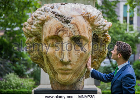 London, UK. 16th May 2018. Emily Young, Cautha, 2012 - Christie's will present 'Sculpture in the Square' an outdoor sculpture garden set within St James's Square, London, on view to the public from 17 May to 20 June 2018. Credit: Guy Bell/Alamy Live News - Stock Photo