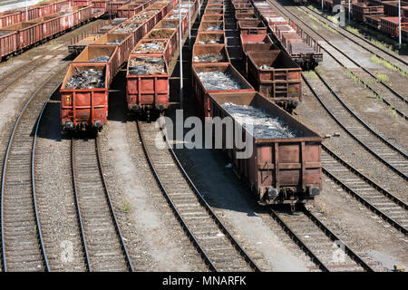 Freight cars loaded with steel scrap - Stock Photo