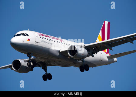 Germanwings Airbus A319 jet plane airliner coming in to land at London Heathrow Airport, UK. A319-100 D-AKNS. Space for copy - Stock Photo