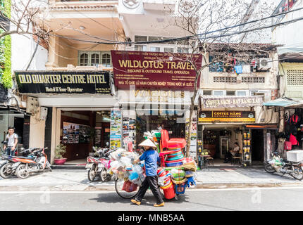Cycle vendor moving round city of Hanoi Vietnam - Stock Photo